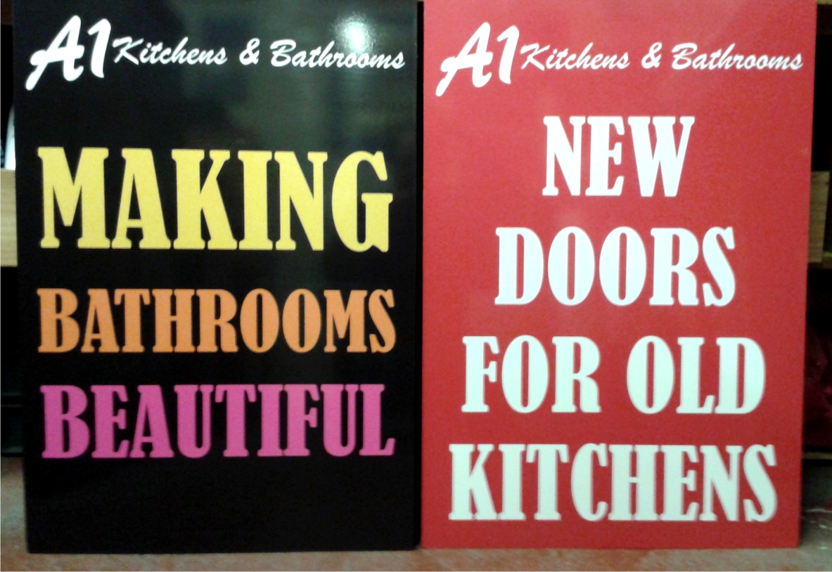 A1 Kitchens 7 Bathrooms promo signs